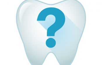 Drawing of a tooth with a question mark on top