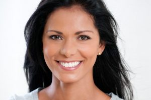 A woman with bright, white teeth