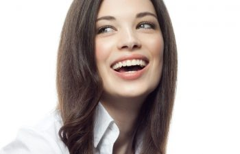 A woman with a bright white, healthy smile
